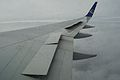 Half lifted wing spoiler of a Boeing 767.jpg