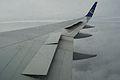 Half lifted wing spoiler of a Boeing 767.jpg