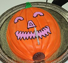 A Halloween cake prepared with the appearance of a jack-o'-lantern