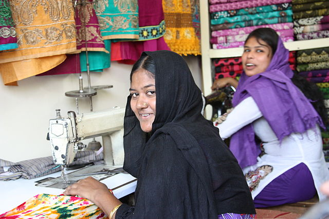 Pictured: Khaleda, a survivor of the Rana Plaza collapse, in her new job as dressmaker
