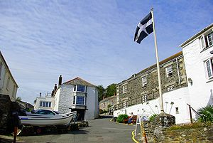 Portloe - The Cornish flag flying in Portloe, to the right of the picture is The Lugger Hotel.