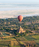 Hot air balloon over a pagoda in Bagan.jpg