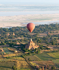 A hot-air balloon flying over one of the many pagodas in Bagan, Myanmar