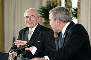 John Howard and U.S. President George W. Bush during a joint press conference in the East Room of the White House in May 2006.