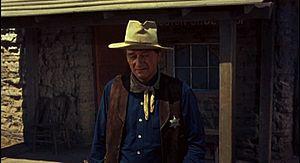 Cropped screenshot of John Wayne from the trai...