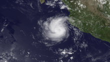 A visible satellite image of a small yet well-developed hurricane in the open East Pacific on July 2.