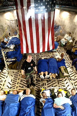 Sick and injured people being evacuated aboard a C-17 Globemaster III