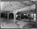INTERIOR, FIRST FLOOR, STALL AREA NORTHEAST VIEW - Morgan Van Wagoner Barn, Hosmer Road, Somerset, Niagara County, NY HABS NY,32-SOM,1B-3.tif