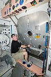 ISS-43 Terry Virts closes the hatch to the PMM.jpg