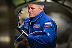 ISS-50 Oleg Novitskiy wearing a flight suit aboard the ISS.jpg