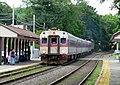 Inbound train arriving at Melrose Cedar Park station, June 2012.JPG