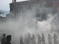 Incense smoke wafts from huge burners in Lhasa