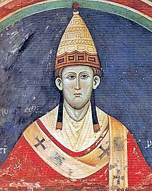 A painting of Pope Innocent III, wearing his formal robes and a tall, pointed hat.