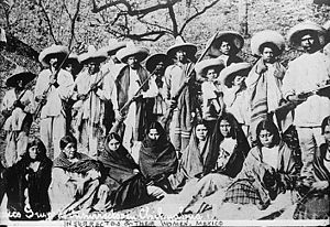 Soldaderas - Revolutionaries and their unarmed Adelitas. Posed undated photo, place unknown