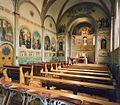 Interieur, overzicht kloosterkapel richting altaar en muurschilderingen - Hulst - 20365777 - RCE.jpg