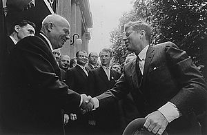 Foreign policy of the John F. Kennedy administration - Kennedy shaking hands with Nikita Khrushchev, 1961.