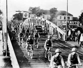French Indochina in World War II - Japanese troops on bicycles advance into Saigon