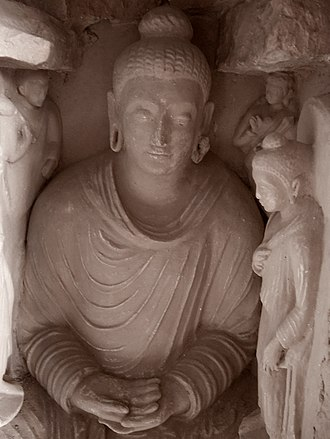 Taxila city - Taxila's ancient Jaulian monastery features images of the Buddha in a syncretic style that draws from local traditions, and those of Ancient Greece.