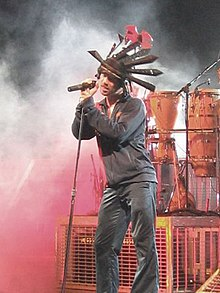 Jay Kay of Jamiroquai performs at a concert.