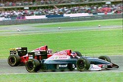 Jean Alesi - Ferrari F193A dives inside Ukyo Katayama - Tyrrell 020C at the 1993 British Grand Prix (33530333172).jpg
