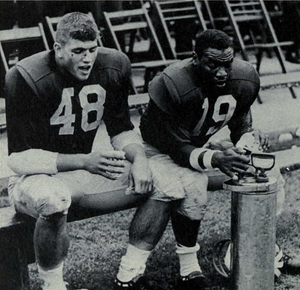1964 Michigan Wolverines football team - Starters Jim Detwiler and Carl Ward rest late in the Northwestern game.