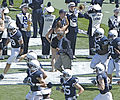 Joe Paterno runs out with team crop.jpg