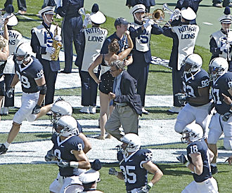 Joe Paterno - Paterno runs out with his team before the start of a game, September 2007