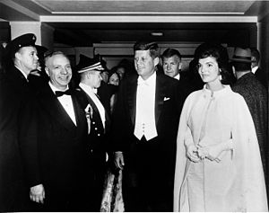 Inauguration of John F. Kennedy - President John F. Kennedy and First Lady Jacqueline Kennedy, wearing a gown designed by Ethel Franken of Bergdorf Goodman, arrive at Sinatra's inaugural ball on the evening of Inauguration Day.