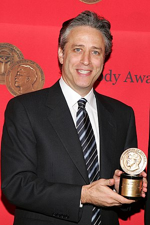 Jon Stewart - Stewart with the Peabody Award that he won with The Daily Show in 2005