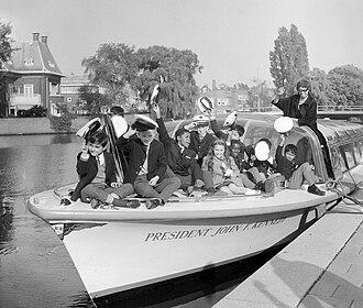 Josephine Baker - Baker with ten of her adopted children, 1964