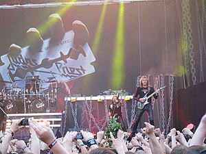 Glenn Tipton - Judas Priest performing at Sauna Open Air in 2011. Glenn Tipton (far right) is playing on his signature Hamer model.