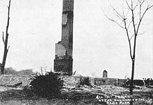a single chimney is all that is left standing after Kehoe's bombs destroyed his farm