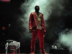 A photograph of Kanye West performing live.