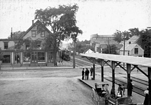 Kentville - Aberdeen Street, Kentville as passenger train arrives, c. 1910
