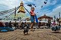 Kid feeding pigeon in Boudhanath.jpg