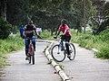 Kids riding their bikes in dedicated lanes.jpg