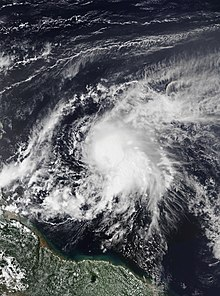 Visible satellite imagery of a strong tropical storm east of the Lesser Antilles on September 26.