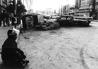 Koza riot - An Okinawan policeman surveys the damage hours after the riot