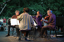 Kronos Quartet performing outdoors