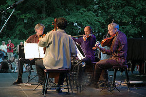 The Kronos Quartet performing in the open air ...