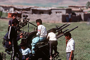 1991 uprisings in Iraq - Kurdish children in a refugee camp built during the U.S. and coalition Operation Provide Comfort play on a ZPU gun which was abandoned by Iraqi forces during Operation Desert Storm, 1 May 1991