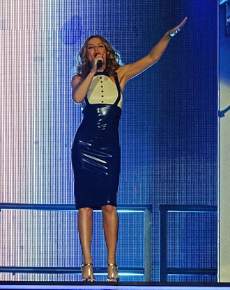 "Kiss Me Once - Minogue performing lead single ""Into the Blue"" during one of the concerts of the Kiss Me Once Tour."