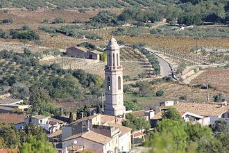 Albinyana - The Church of St. Bartholomew of Albinyana seen from the Sant Antoni hermitage.
