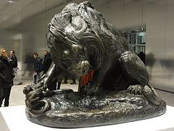 Français: Lion au serpent