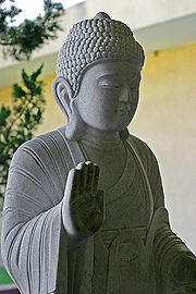 Because of its lack of a personal God, Buddhism is commonly described as atheistic.