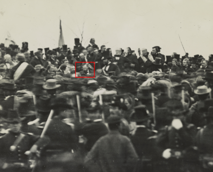 Lincoln, absent his usual top hat, is highlighted at Gettysburg. Lincoln's Gettysburg Address, Gettysburg, highlighted version.png