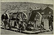 Boer Long Tom gun packed for travel on board a train with the barrel removed from the carriage.