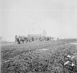 Long line of people in front of post office, Nome, Alaska, between 1895 and 1905 (AL+CA 2562).jpg