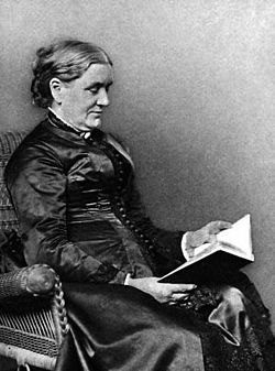 Lucy Larcom seated with book.jpg