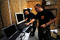 Macedonian Armed Forces Capt. Marjan Zafirovski, right, and Sgt. Spase Trajkoski, left, unpack computer equipment during Combined Endeavor at Mihail Kogalniceanu International Airport in Romania Aug. 31 100831-F-XH331-122.jpg